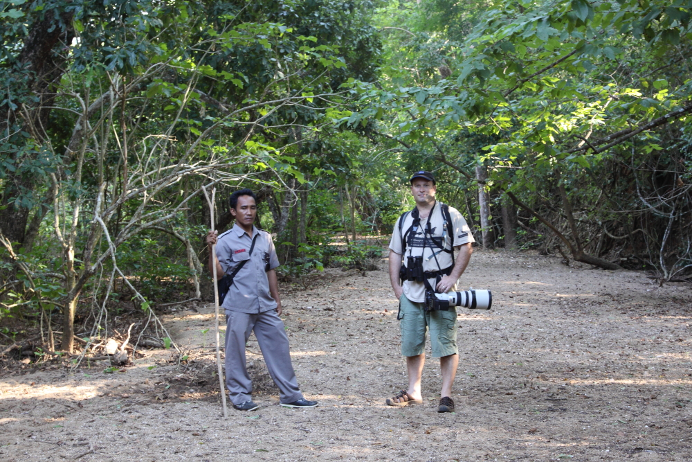 The author on Komodo Island accompanied by a park ranger – notice the forked stick which is carried at all times to deter any Komodo Dragon attacks. Image by Felicity Riley